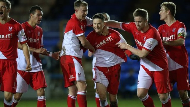 Harriers players celebrate Joe Lolley's matchwinning goal at London Road