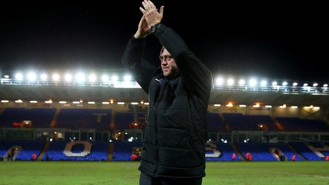 Kidderminster Harriers manager Andy Thorn applauds the visiting fans after his side's FA Cup win at Peterborough