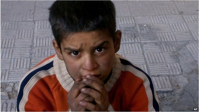 Child in the Palestinian camp of Yarmouk near Damascus
