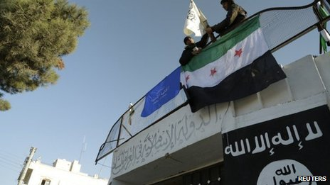 Free Syrian Army fighters erect the Syrian opposition flag