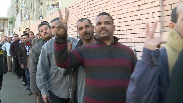 Man queue up to vote