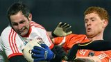 Tyrone's Ronan McNabb battles with Kyle Carragher