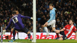 Edin Dzeko scores for Manchester City against Blackburn
