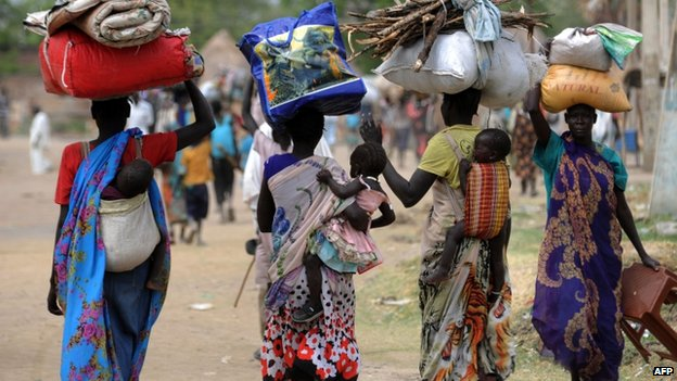 Displaced South Sudanese women walk towards the United Nations mission base in Malakal, South Sudan - 13 January 2014