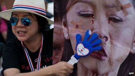 Anti-government protester in Thailand, with a defaced image of Ms Yingluck ( file picture)
