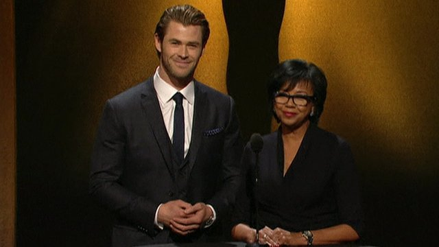 Chris Hemsworth and Academy President Cheryl Boone Isaacs