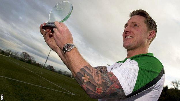 Kris Commons shows off his player of the month award