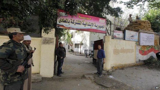 Guards at Cairo polling station, 13 Jan
