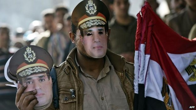 Street vendor with Sisi masks, Cairo 15 Jan
