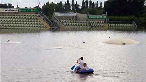 Canoeists on cricket ground