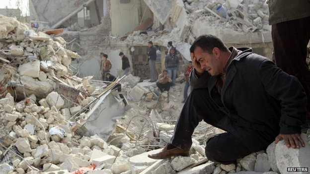 A man cries at a site hit by what activists said was a Scud missile in Aleppo's Ard al-Hamra neighbourhood, in this February 23, 2013 file photo