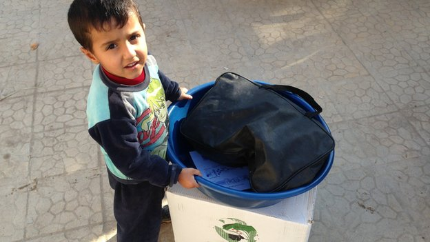 A Syrian boy during distribution of food aid and hygiene kits in Deir Alzour in November 2013