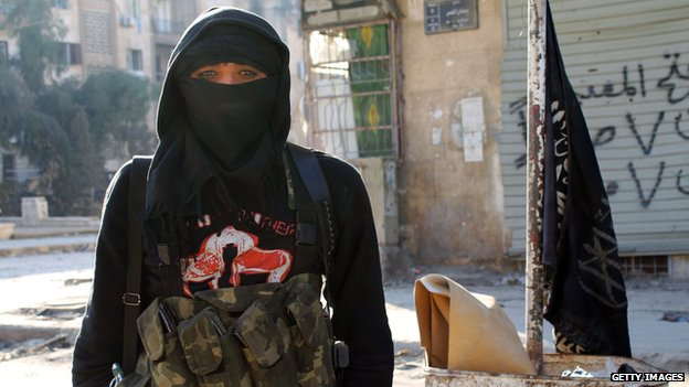 A member of jihadist group Al-Nusra Front stands in a street of the northern Syrian city of Aleppo on January 11, 2014