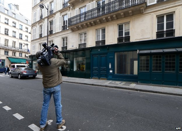 A cameraman films the Parisian apartment building which featured in Closer magazine, 13 January