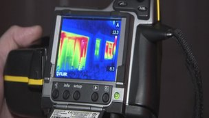 Infrared camera displaying heat loss on the exterior of a house
