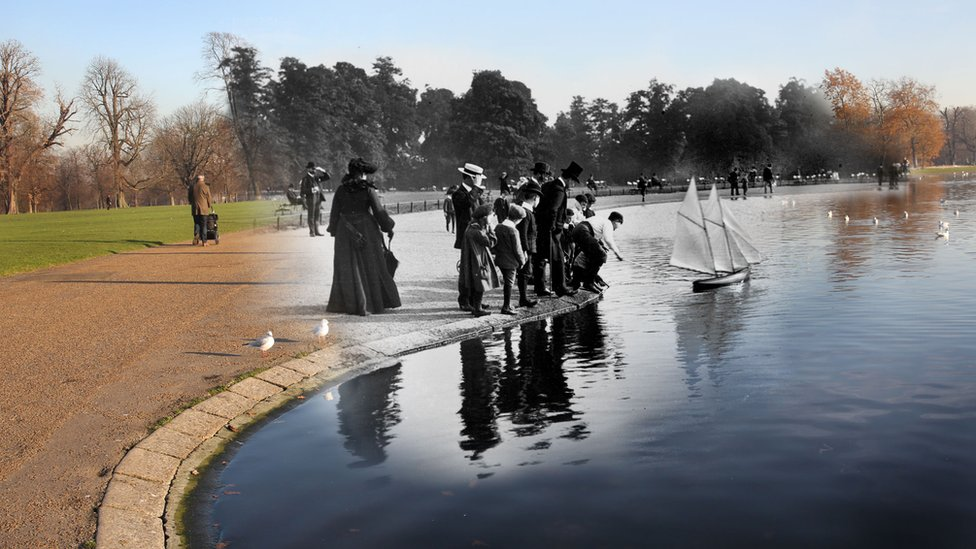 A black and white image of children sailing a model yacht in a park superimposed over a modern day photo of the same scene