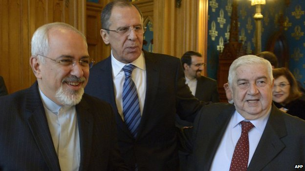 Iranian Foreign Minister Javad Zarif, with Russia's Sergei Lavrov and Syria's Walid al-Moallem in Moscow on 16 January 2014
