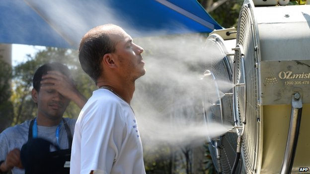 A tennis fan tries to cool off from the heat on day four of the 2014 Australian Open tennis tournament in Melbourne on 16 January 2014