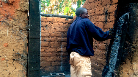 Jerome Ngaina returns to his burnt out house in Bokongo village, Central African Republic