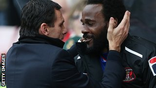 Carlisle defender Pascal Chimbonda (right) speaks to Sunderland manager Gus Poyet left before January's FA Cup tie