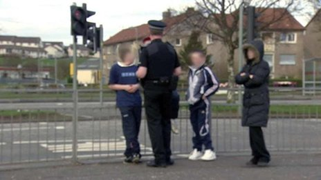 Police officer searching youngsters