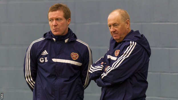 Hearts boss Gary Locke (left) and assistant Billy Brown