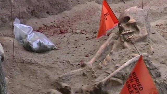 Skeleton remains in grave