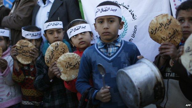 Palestinian children in the Yarmuk refugee camp in Damascus on 8 January 2014
