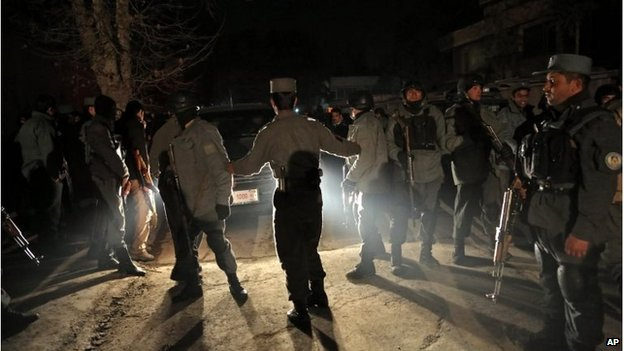 Afghan security forces work at the site of a suicide attack in Kabul, Afghanistan, January 17