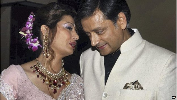 Shashi Tharoor listens to his wife Sunanda Pushkar at their wedding reception in Delhi, September 2010