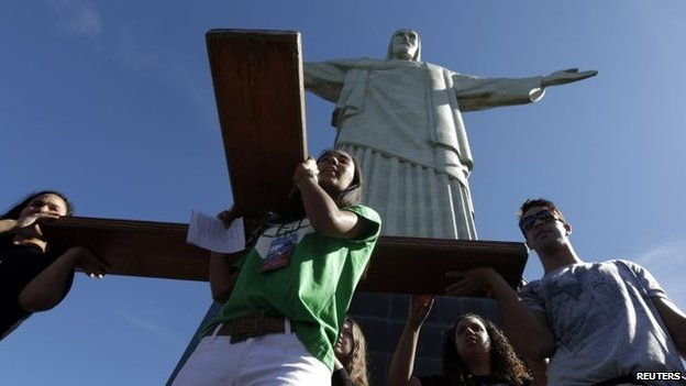 Youths carry the World Youth Day cross during a visit to the Christ the Redeemer statue