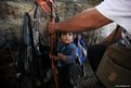 A child helps his father arrange weapons at a checkpoint of the Self-Defense Council of Michoacan, (CAM), in Tancitaro, Mexico