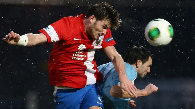 Linfield's Philip Lowry heads in against Ballymena United