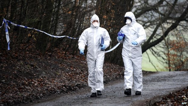 Forensic officers in woodland