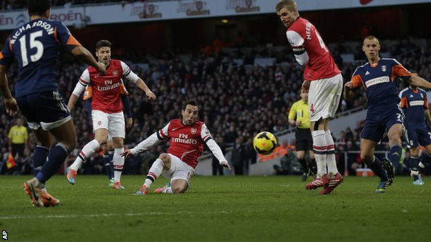 Santi Cazorla (centre) scores the opener for Arsenal against Fulham