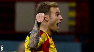 Partick Thistle's Kallum Higginbotham celebrates after scoring against Kilmarnock