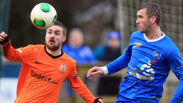 Glenavon's Tiarnan Mulvenna in action against Ryan Campbell of Ballinamallard