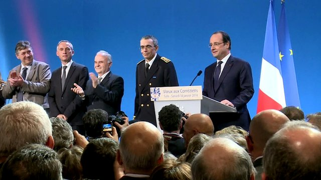 President Hollande (far right) in Tulle