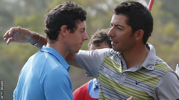 Rory McIlory (L) congratulates Pablo Larrazabal on wining the Abu Dhabi Championship
