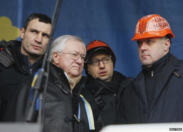 Speakers gather on stage at protest in Kiev, 19 January