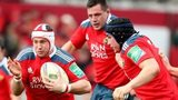 Johne Murphy steps inside Dave Denton to score Munster's second try