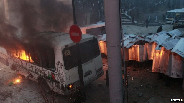 Police van which was attacked after a pro-European integration protest burns