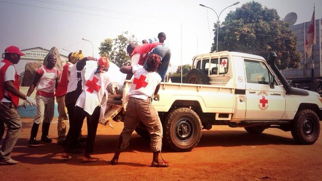 Aid workers carry bodies to a truck, Bangui, 19 January