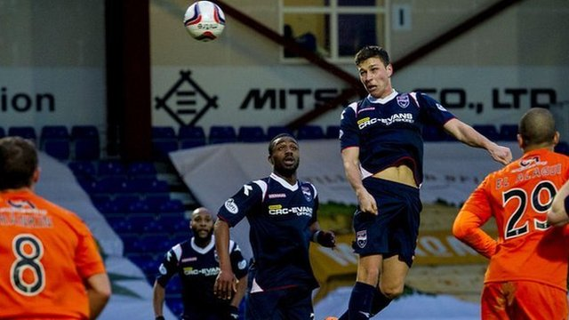 Filip Kiss heads home the first goal for Ross County