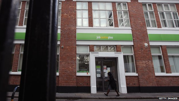 LONDON - OCTOBER 21: A woman walks by a Job Centre in Westminster on October 21, 2010