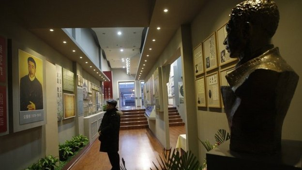 """This picture taken on January 19, 2014 shows a Chinese visitor looking at exhibits at a memorial in Harbin, north-eastern China""""s Heilongjiang province, to honour Ahn Jung-Geun"""