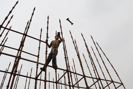 Chinese worker on scaffolding