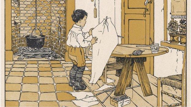An illustration of a boy making a kite tin his kitchen