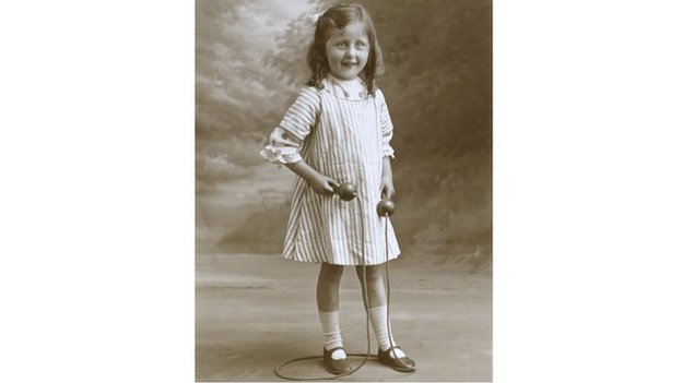 Portrait of a young girl playing with a skipping rope circa 1910