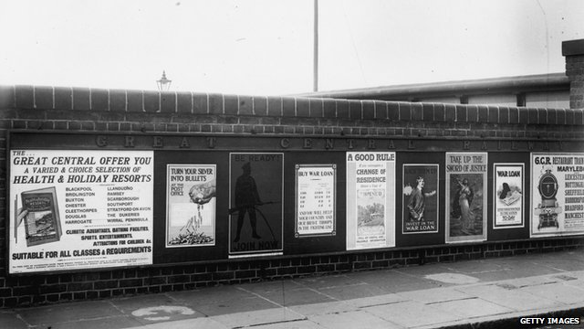 Recruiting and other war posters on  a railway bridge